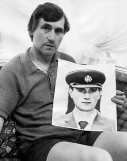 Valentich's father holds a photograph of his son