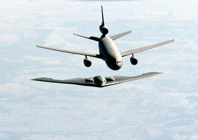 A B-2 Spirit Bomber aircraft on approach to aerial refueling from a US Air Force KC-10A Extender Aircraft from McGuire AFB, New Jersey during a training exercise.