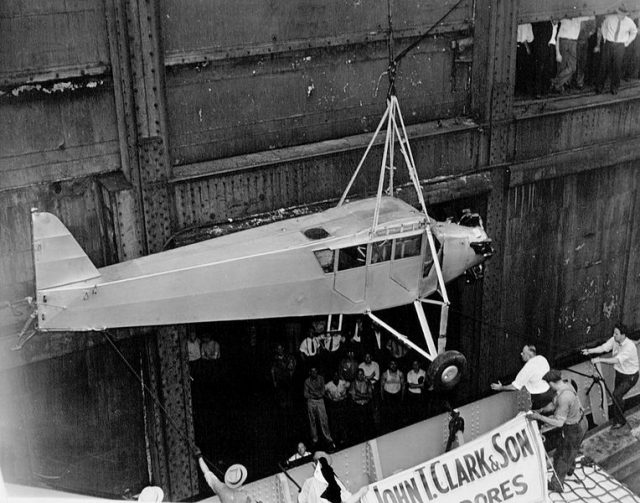 Douglas Corrigan's plane returning to the US via ship 1938