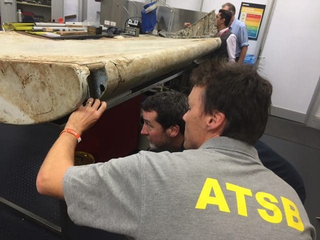 Examining piece of aircraft debris at ATSB