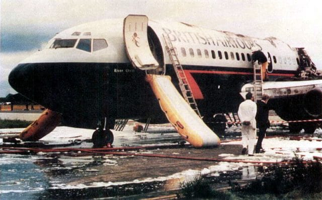 Forward section of the aircraft showing left and right escape slides deployed.