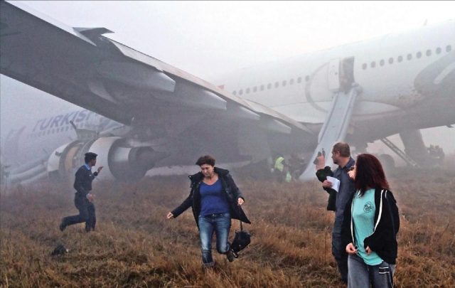 Passengers evacuating using emergency slides