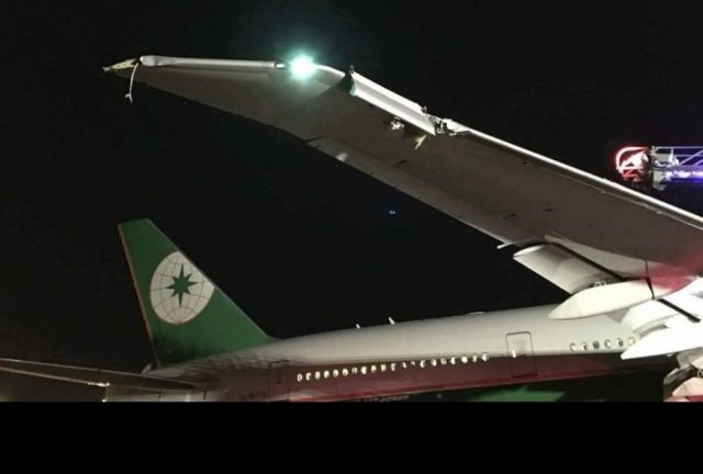 JACDEC: EVA Air Boeing 777-300 (B-16718) struck pole when taxiing out the de-icing area in darkness (~01:00L) at Toronto-Intl Airport